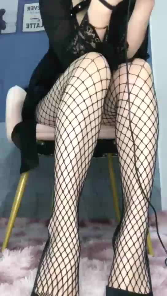 Fishnet stockings, black high heels, first perspective