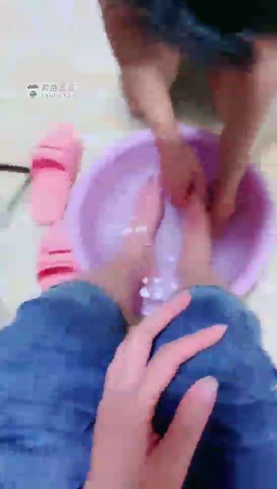 Domestic slave waits to wash feet