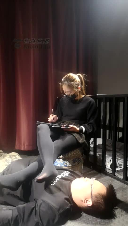 Student queen, stepping on male slave, doing homework