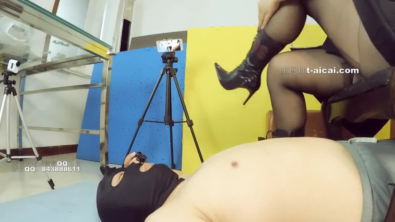 Black silk, boots stomping on the face, humiliating the poor male slave