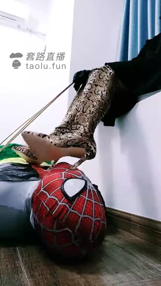 Struggling to humiliate and control Spider-Man