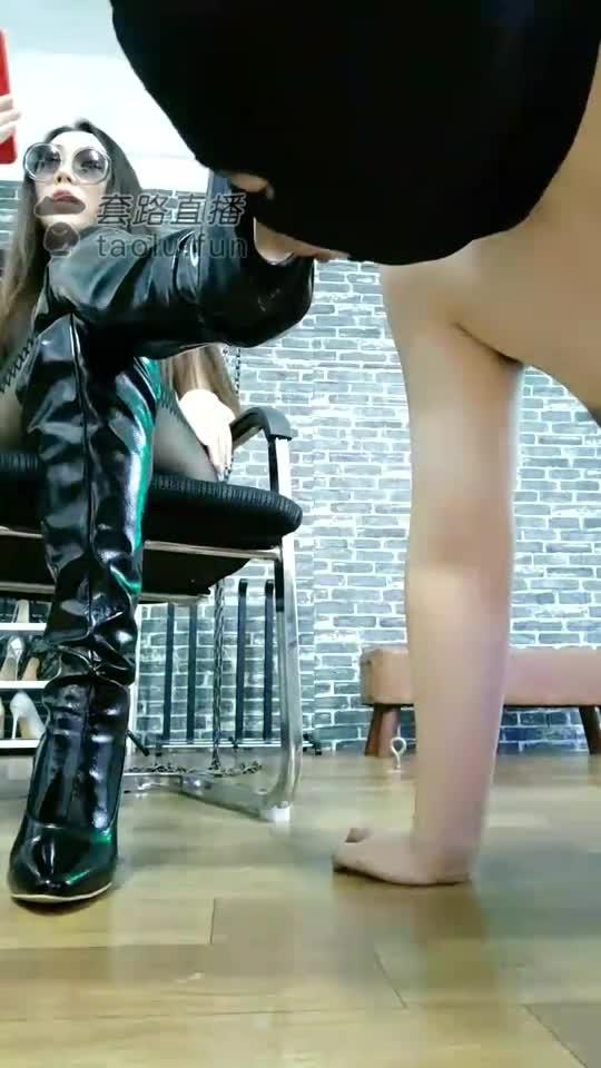 High-heeled boots humiliated
